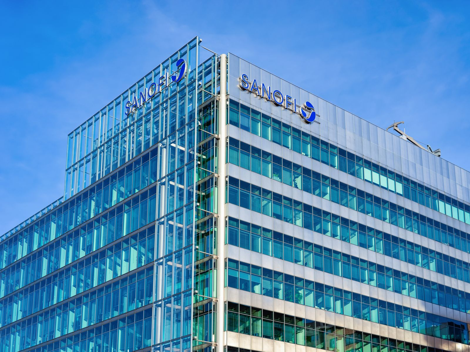 Blue glass European building architecture with Sanofi logo Berlin