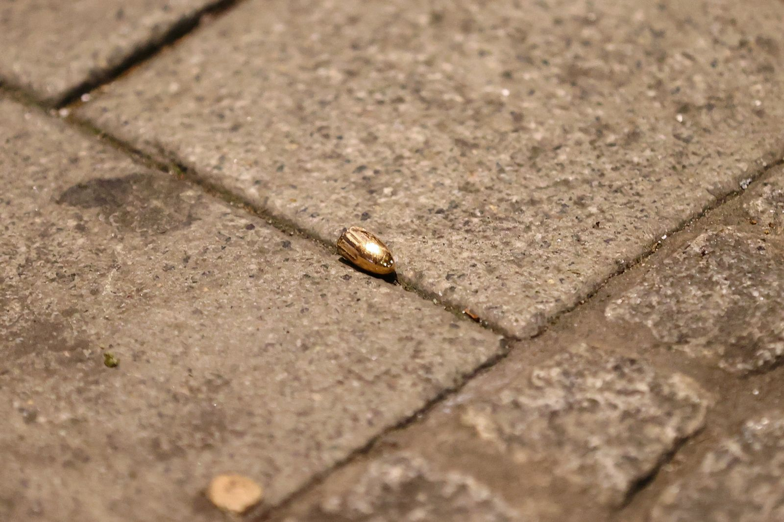 A bullet is seen on the ground after a shooting in Hanau near Frankfurt
