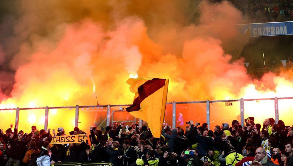 This image taken during a match last week is what often happens when BVB Borussia Dortmund plays Schalke 04.