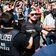 Dutzende Polizisten bei Demonstrationen verletzt