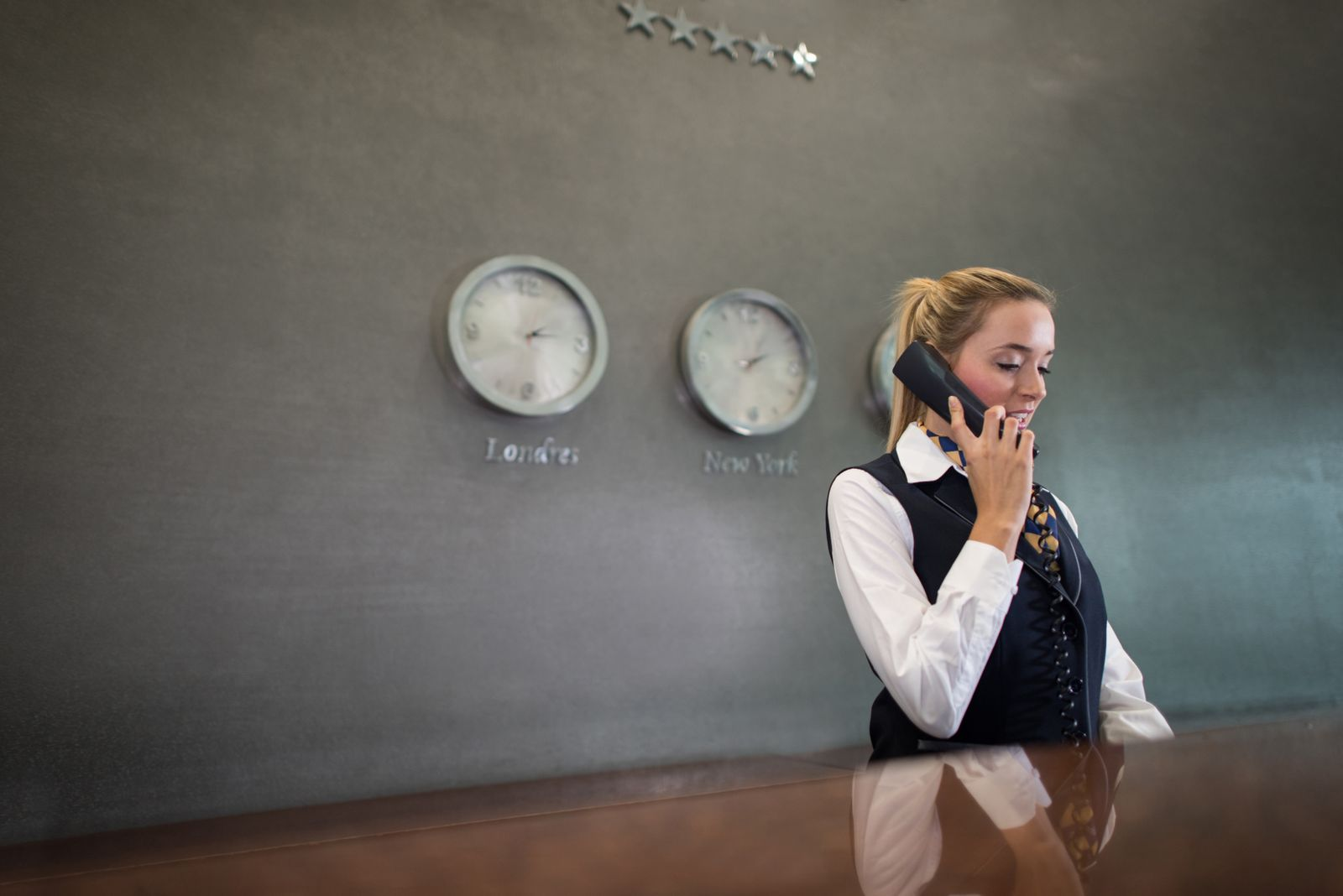 Woman running the front desk at a hotel