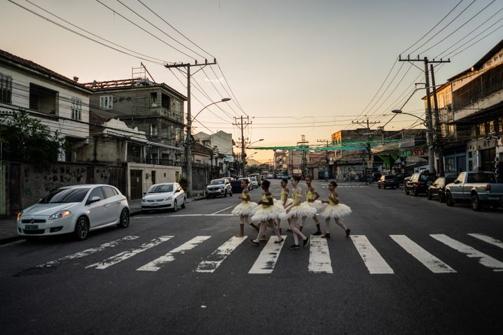 Girls in tutus make their way to ballet lessons. Knowing journalists were present, the girls put on their finest ballet costumes.