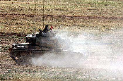 Turkish soldiers take part in a military exercise 50 km from the Iraqi border on Thursday. Tensions have been rising after cross-border incursions by Kurdish rebels, based in northern Iraq.