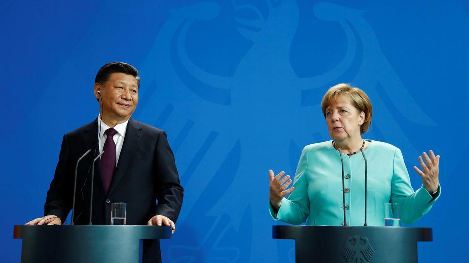 Angela Merkel im Gespräch mit Chinas Präsident Xi Jinping