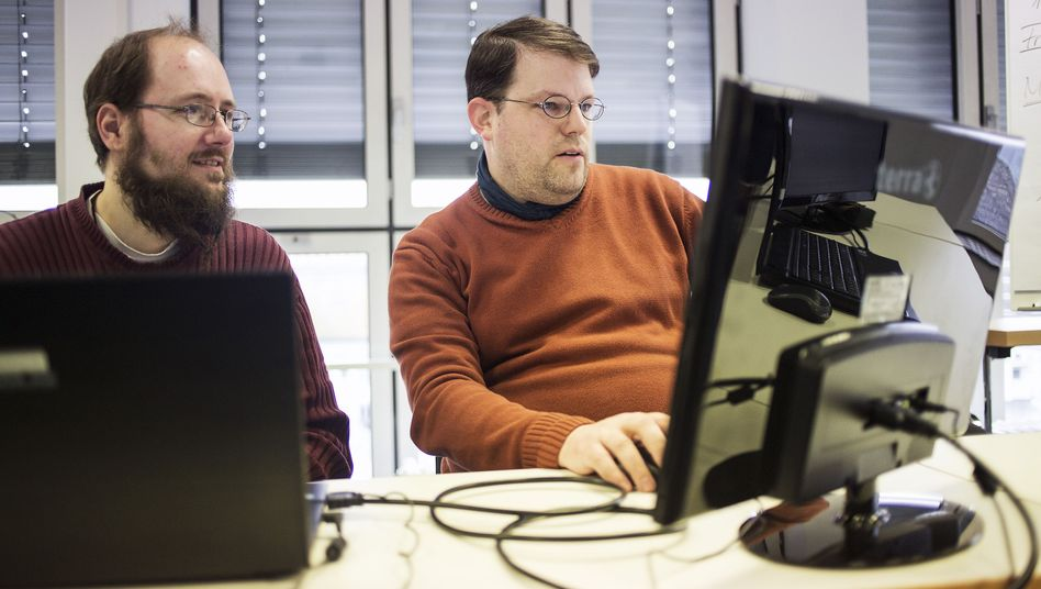Sascha Goldmann (left) and Philipp von der Linden work at IT company Auticon, which contracts people with autism to work as consultants.