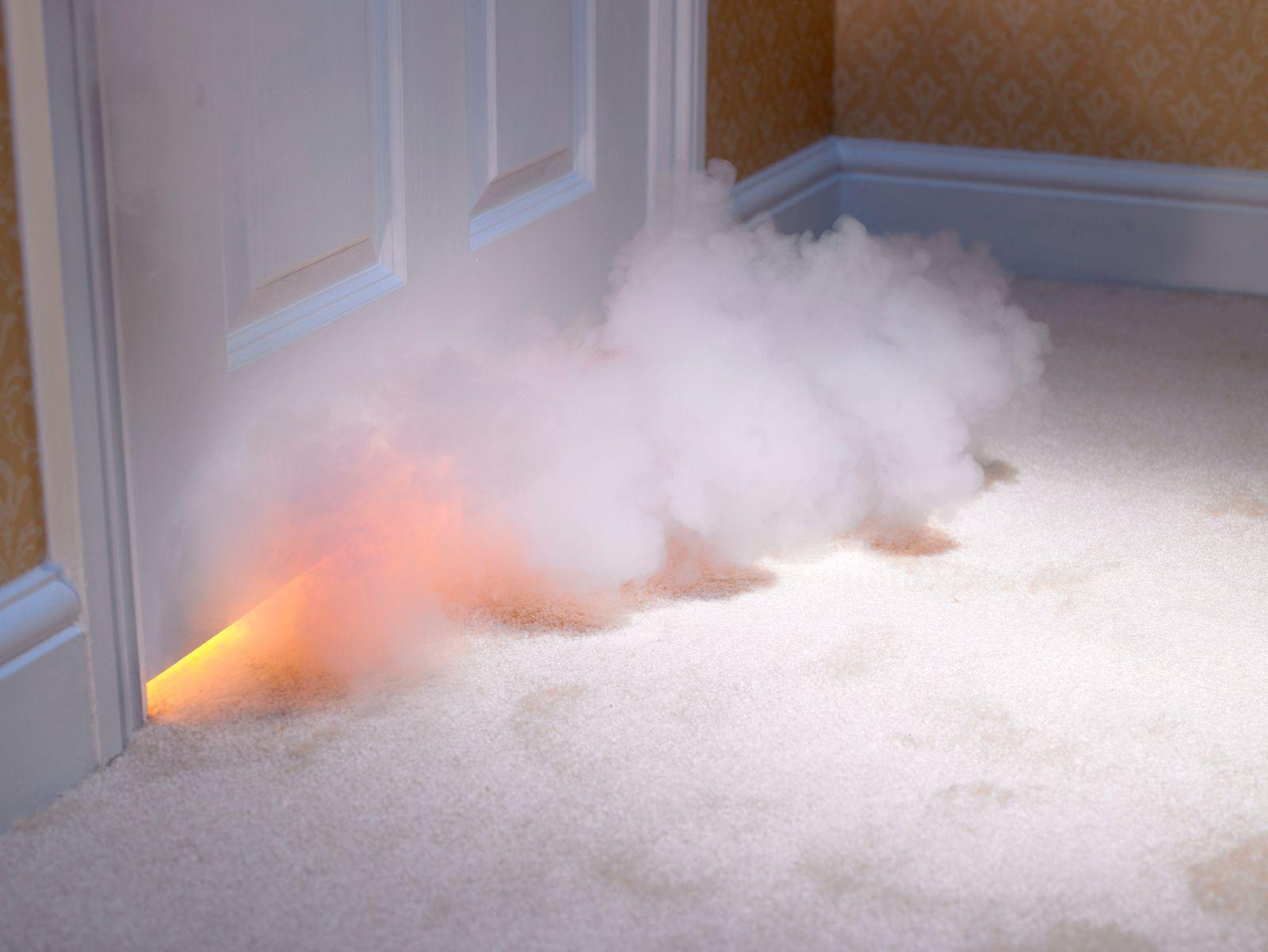 Smoke coming in under door