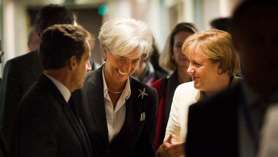 German Chancellor Angela Merkel talks to President of the International Monetary Fund (IMF) Christine Lagarde and French President Nicolas Sarkozy (left) in Brussels.