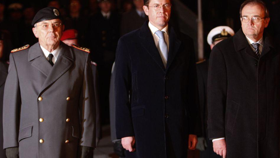 Former Bundeswehr Inspector General Wolfgang Schneiderhan, German Defense Minister Karl-Theodor zu Guttenberg and ex-Defense Ministry State Secretary Peter Wichert.