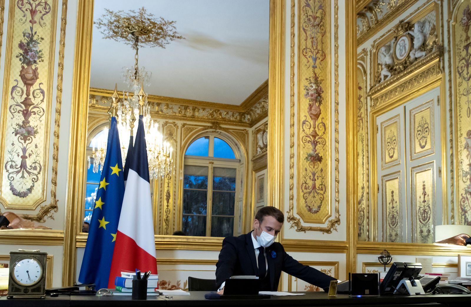 FILE PHOTO: French President Macron speaks on the telephone with U.S. president elect Biden
