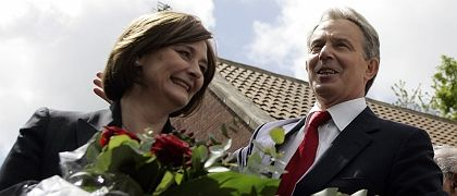 British Prime Minister Tony Blair and his wife Cherie leave the Trimdon Labour club after announcing he will step down.