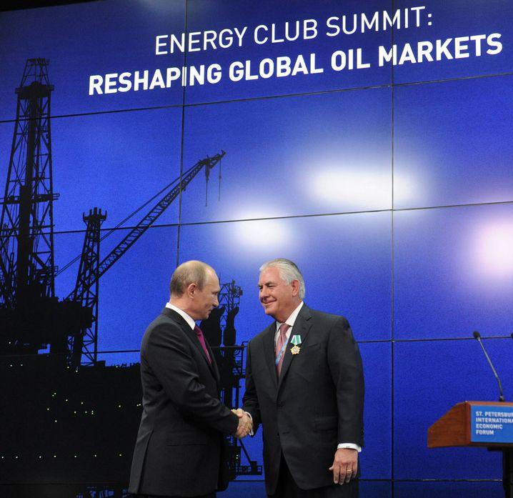 Wladimir Putin und Rex Tillerson