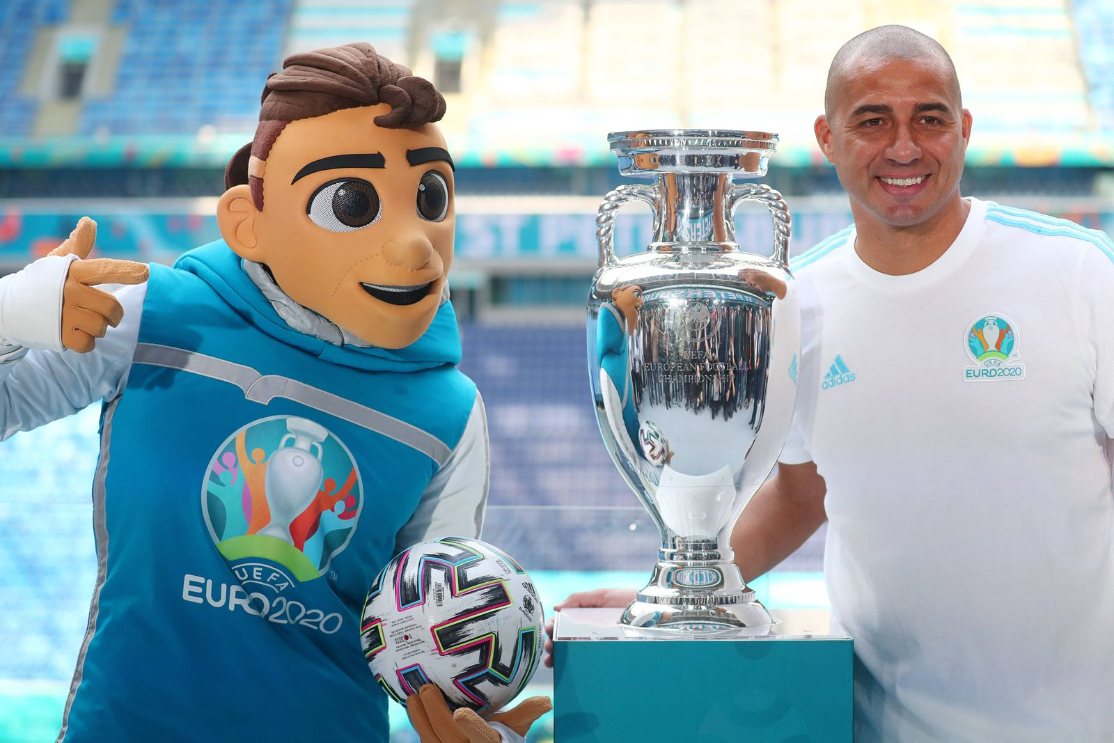 ST PETERSBURG, RUSSIA MAY 22, 2021: A costumed character representing Skillzy, the official Euro 2020 mascot (L), and