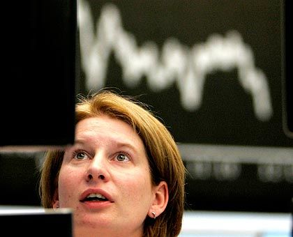 A dealer on Monday in Frankfurt. German shares rose in value after the rescue package was approved by the cabinet.