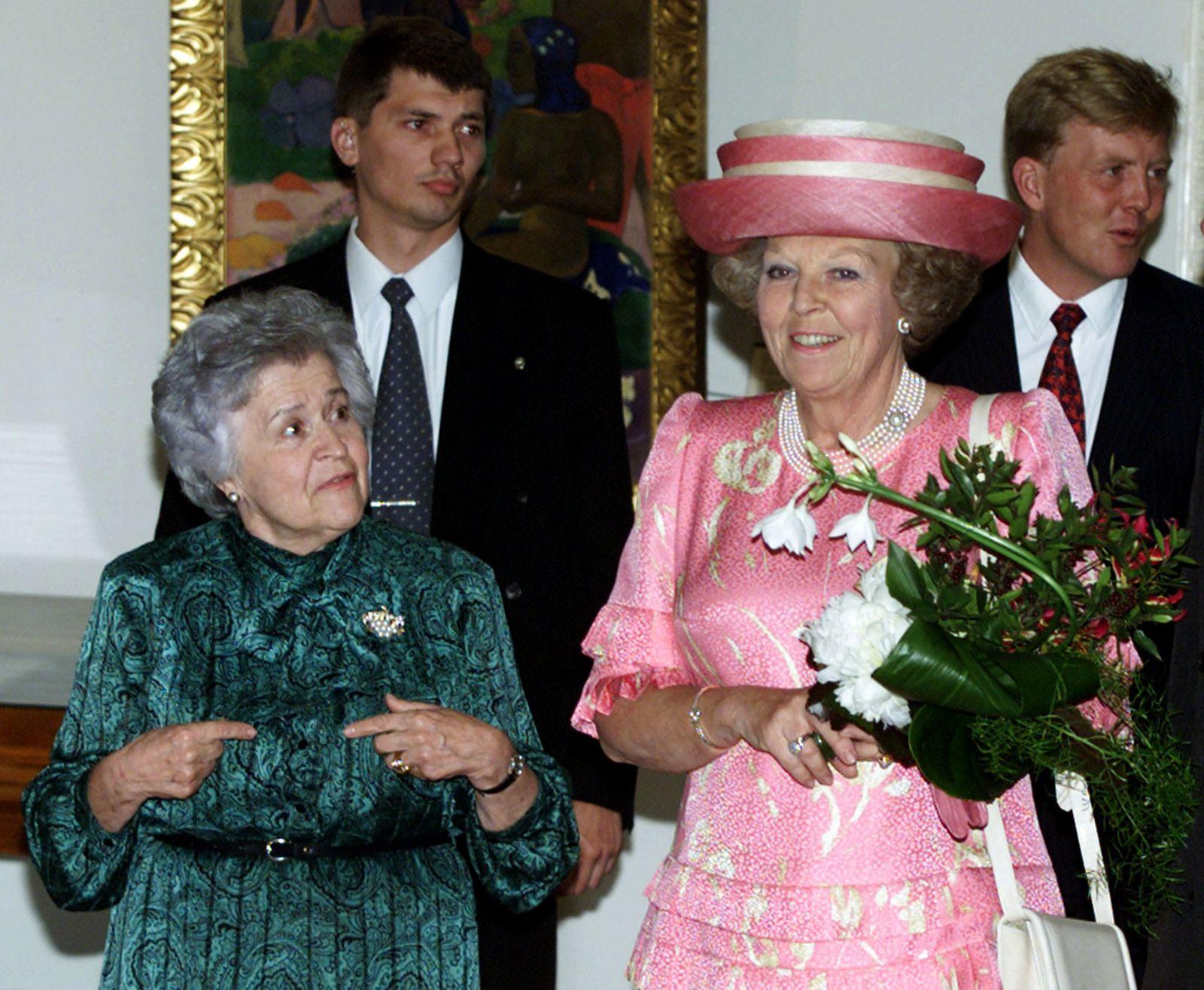 Queen Beatrix of the Netherlands (R) listens to Irina Antonova, director of the Pushkin Museum of Fi..