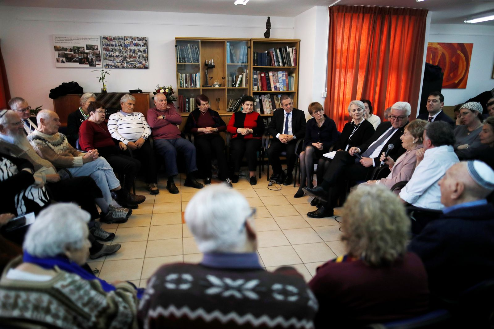 FILE PHOTO:German President Frank-Walter Steinmeier meets with people, including Holocaust survivors, during a visit to AMCHA, a group providing support to Holocaust survivors in Israel, in Jerusalem