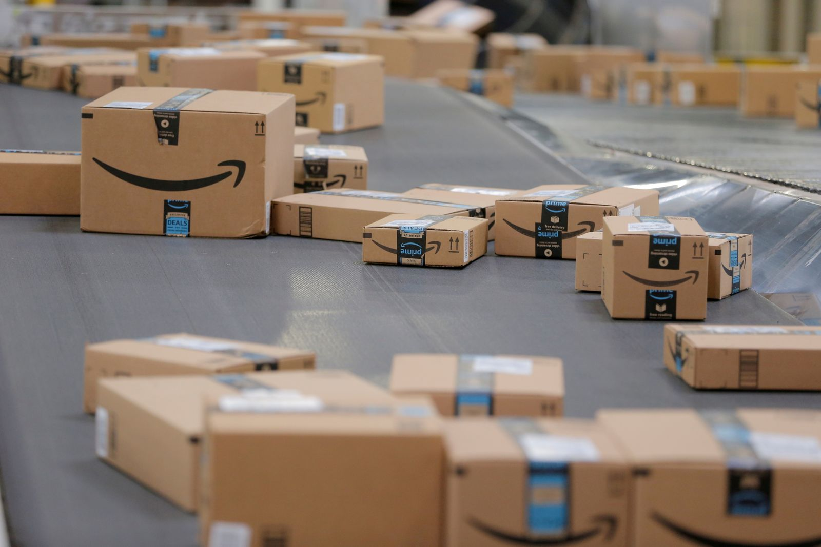 FILE PHOTO: Packages travel along a conveyor belt inside of an Amazon fulfillment center in Robbinsville, New Jersey