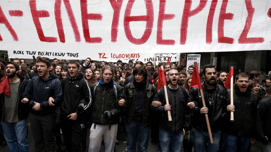 Protesters march against austerity measures in Athens on Thursday.