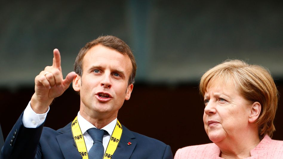 French President Emmanuel Macron and German Chancellor Angela Merkel in Aachen on Thursday.