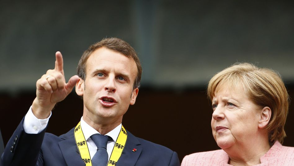 French President Emmanuel Macron and German Chancellor Angela Merkel in Aachen on Thursday.