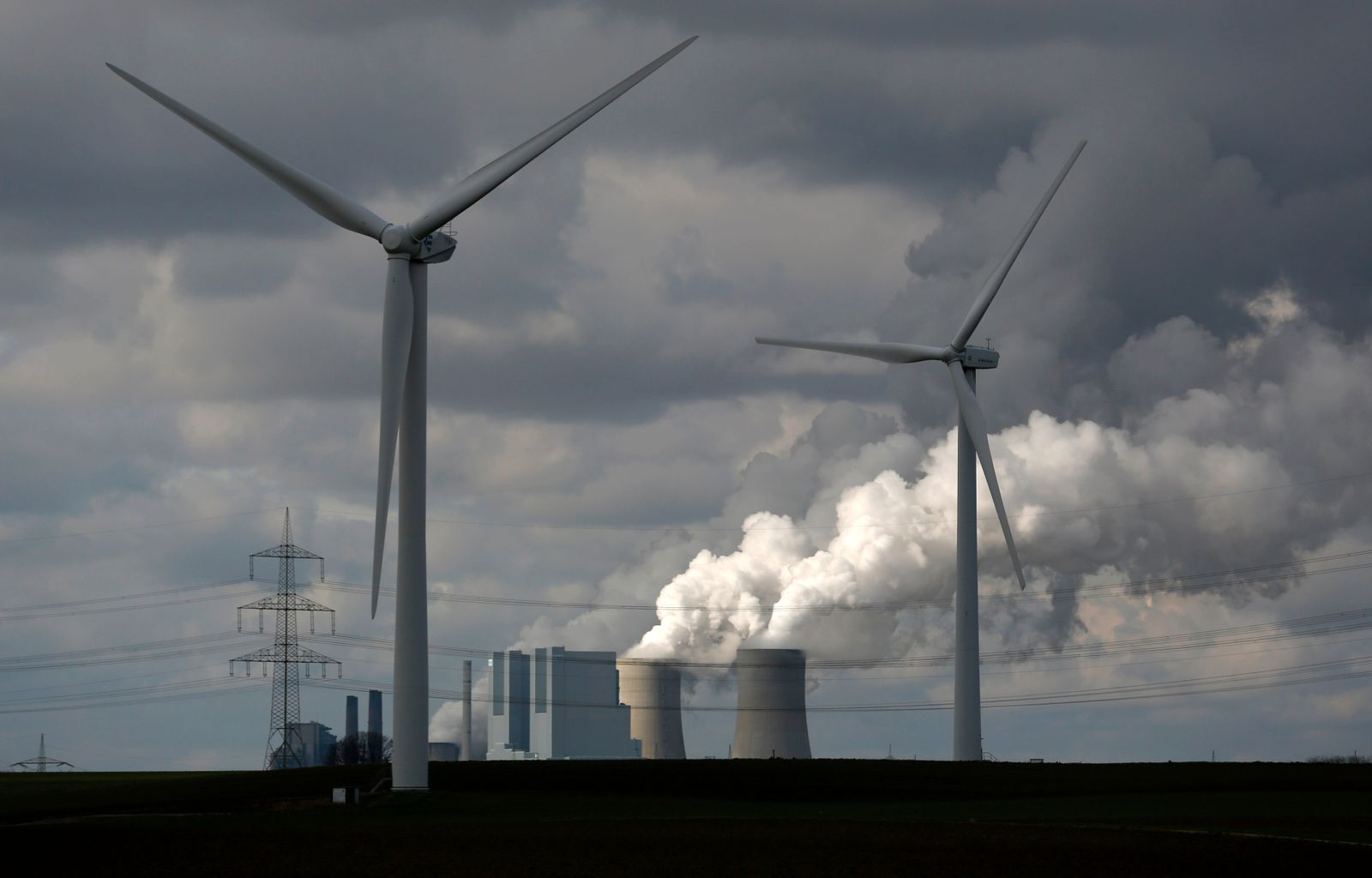File photo of wind turbines in front of a coal power plant of German utility RWE Power near the western town of Neurath