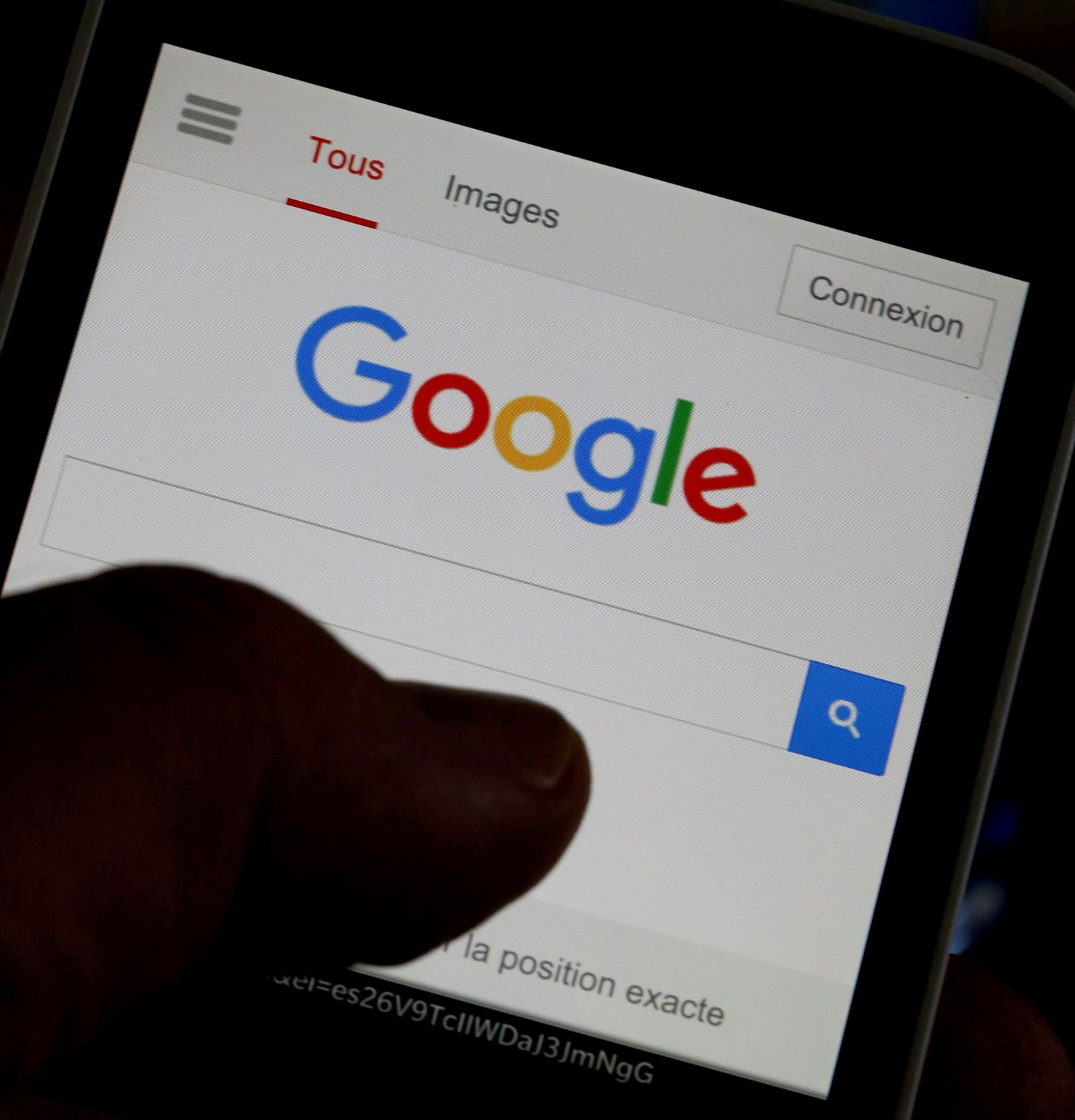 FILE PHOTO: A man holds his smartphone which displays the Google home page, in this picture illustration taken in Bordeaux, Southwestern France