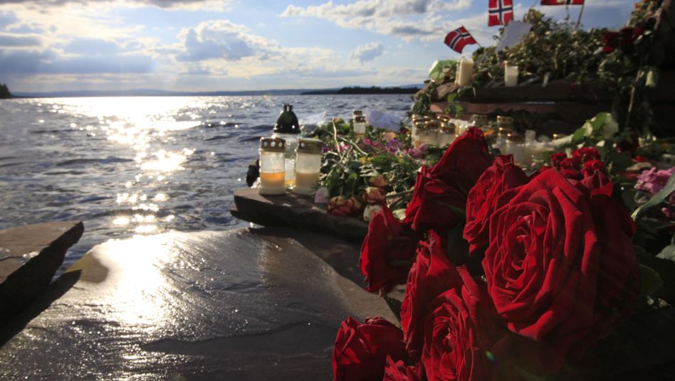 A file photo shows flowers and tributes for the victims of Anders Behring Breivik near the island where he gunned them down in 2011.