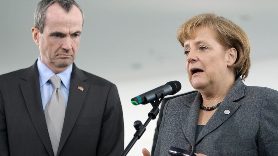 "US Ambassador to Germany Philip Murphy and German Chancellor Angela Merkel: German-American relations remain ""trusting and close."""