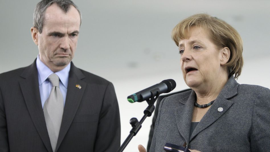 "US Ambassador to Germany Philip Murphy and German Chancellor Angela Merkel: German-American relations remain ""trusting and close."""