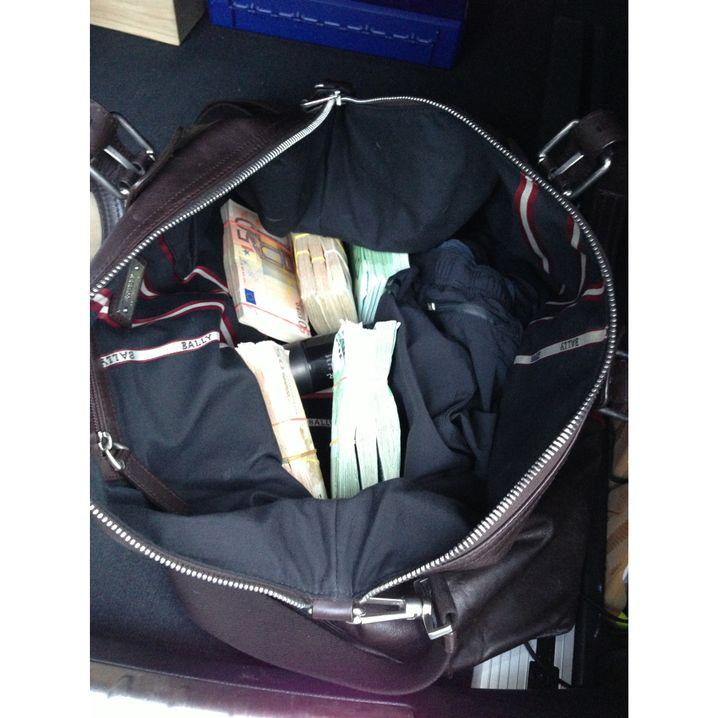 A designer gym bag with wads of cash.