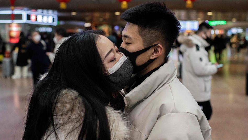 Maskiertes Pärchen in Peking