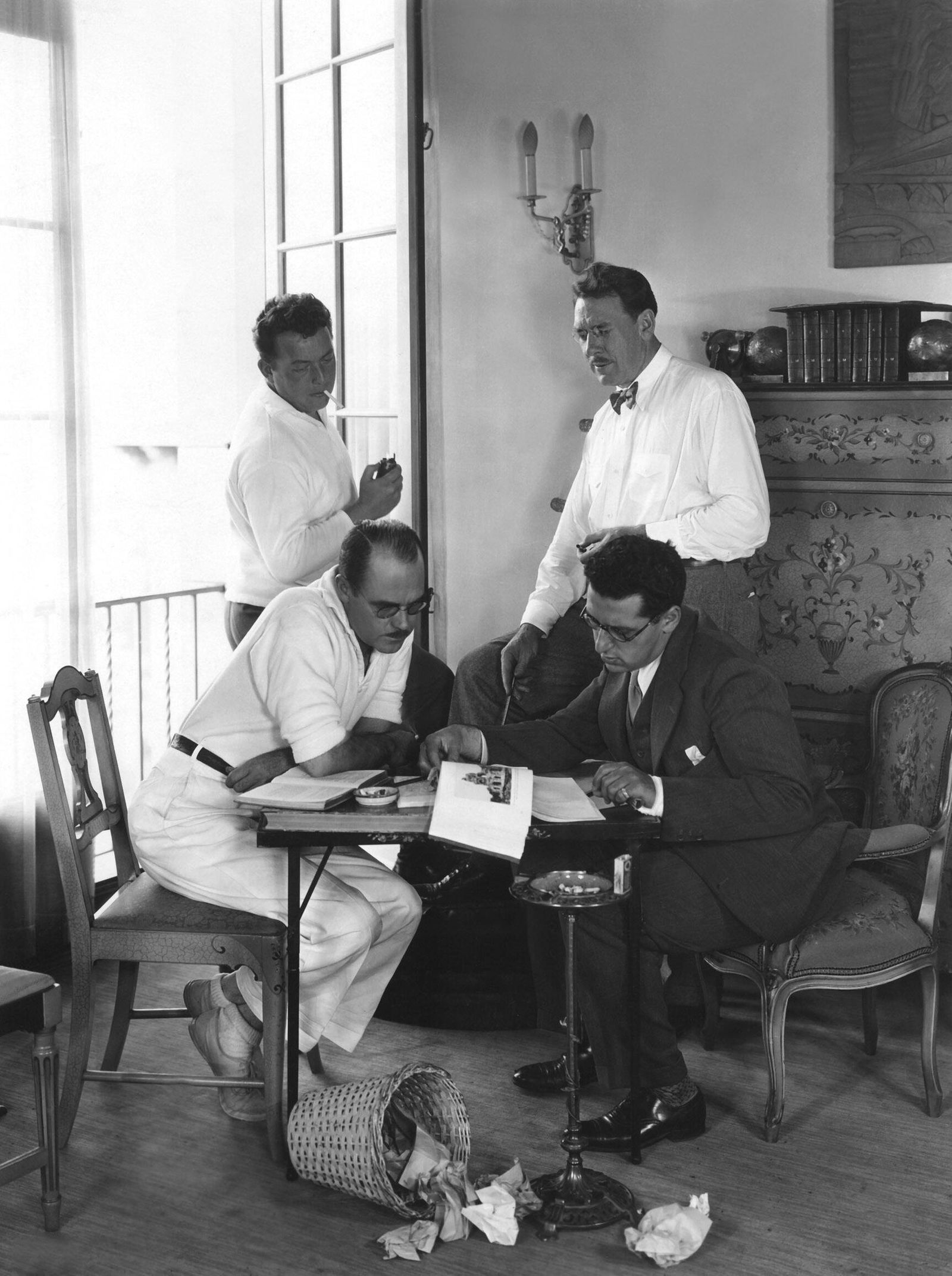 Director LEWIS MILESTONE, scenarist DELL ANDREWS, advisor GEORGE CUKOR and dialogue author MAXWELL ANDERSON plot out ALL