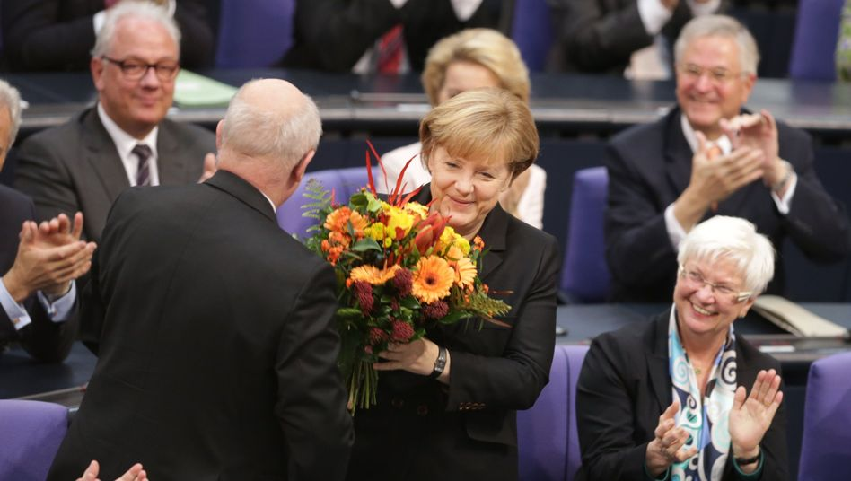 Merkel accepts flowers after Germany's lower house of parliament voted her into her third term as chancellor on Dec. 17.