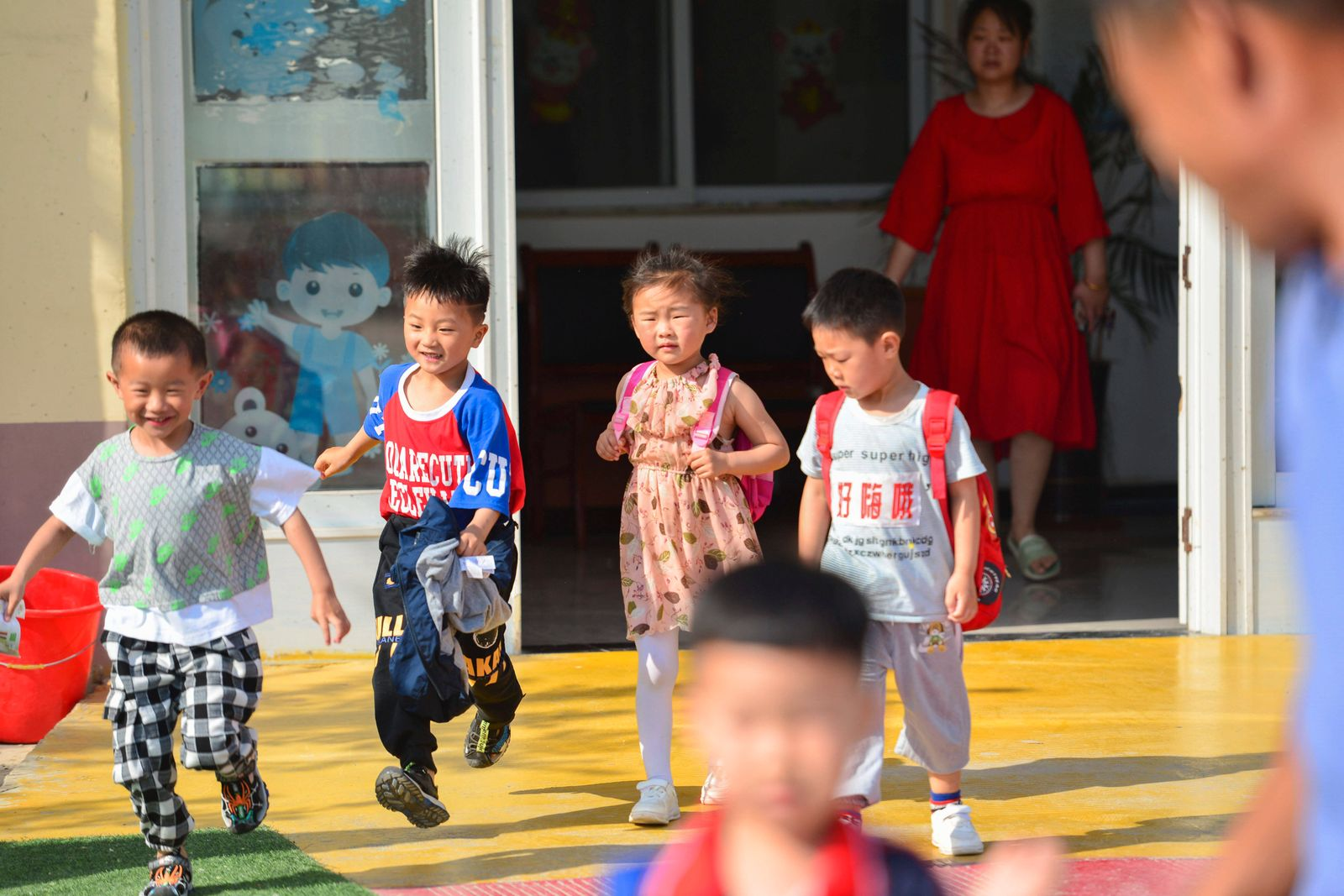 May 31, 2021, Fuyang, Anhui, China: Children run out of their classes after school at a central kindergarten of lvzhai T