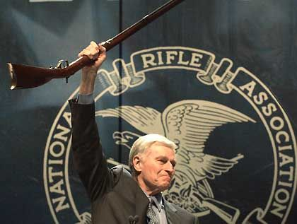 """Former NRA president Charlton Heston: If you want my gun, you'll have to """"pry it from my cold, dead hands."""""""