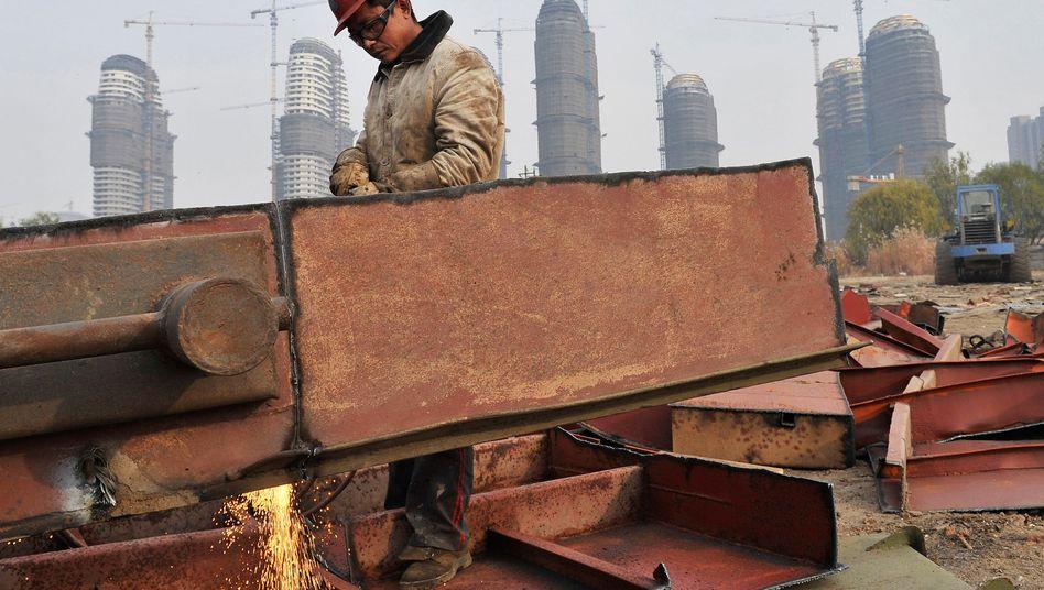 Arbeiter auf einer chinesischen Baustelle: Staatsführung unter Druck