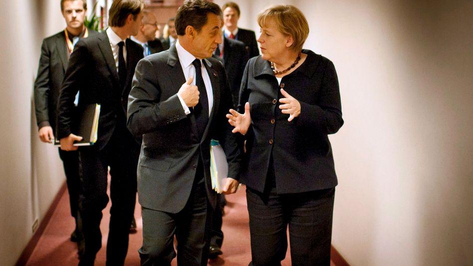 Frankreichs Präsident Sarkozy, Kanzlerin Merkel: Schulden globalisieren