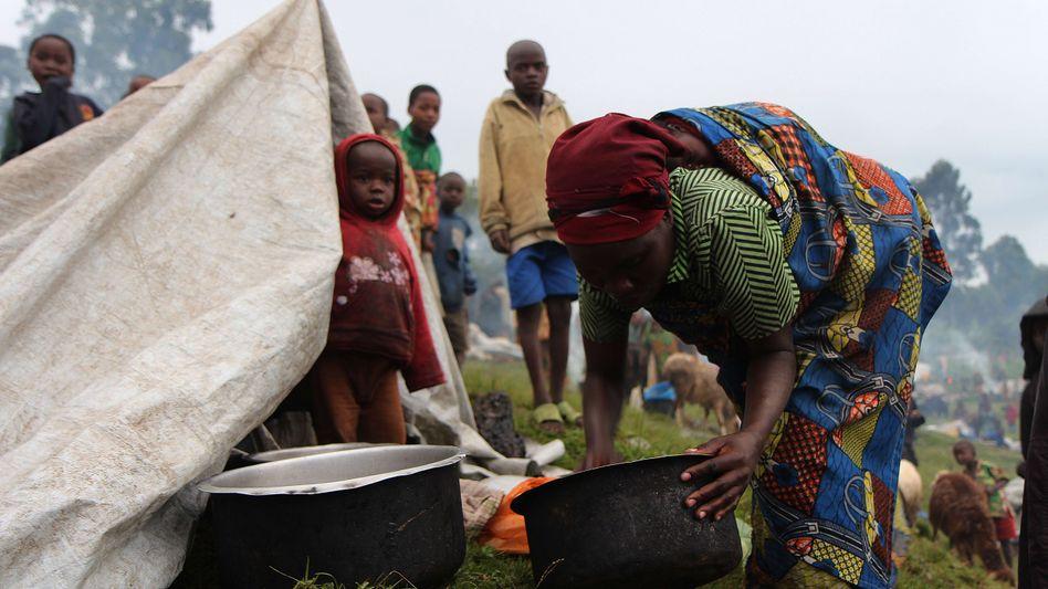 Flüchtlinge an der Grenze zu Uganda: M23 bricht eigenen Waffenstillstand