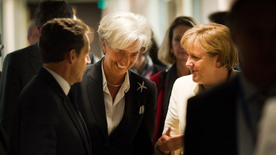 IWF-Chefin Lagarde (Mitte), Euro-Retter Merkel und Sarkozy: Künftig auch mit China?