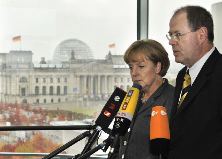 Bundeskanzlerin Merkel und Finanzminister Steinbrück am 5. Oktober 2008