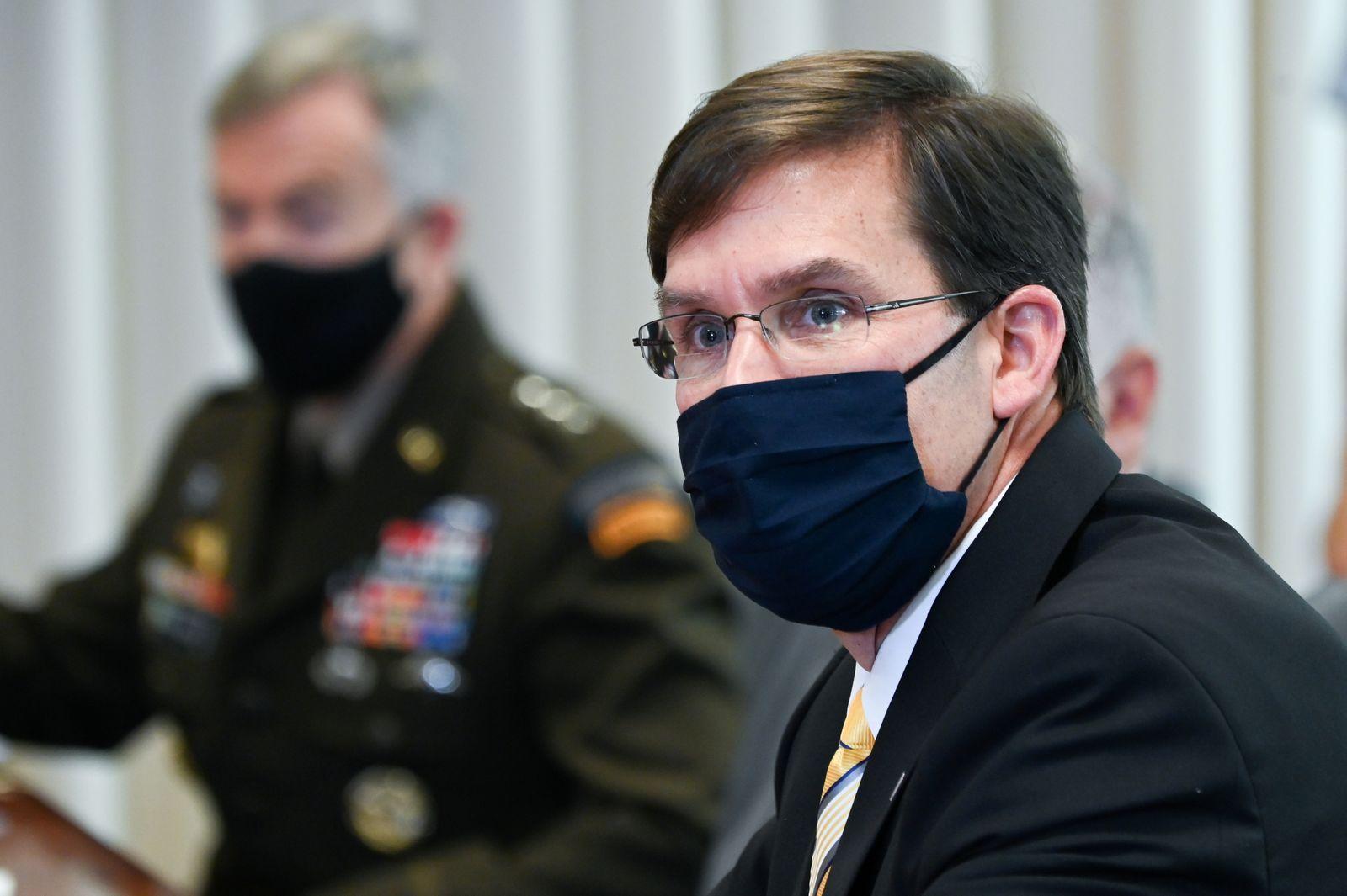 FILE PHOTO: U.S. Defense Secretary Esper participates in a meeting at the Pentagon in Arlington, Virginia