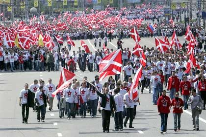 Tens of thousands young people in T-shirts bearing Soviet-style red stars march to a patriotic rally organized by the nationalist pro-Kremlin youth group Nashi, a group controlled by Vladislav Surkov.