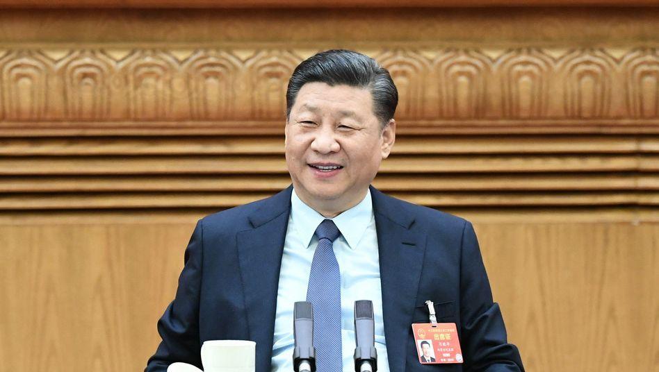 Xi Jinping, Präsident von China, verfolgt eine eigenwillige Art von Entwicklungshilfe