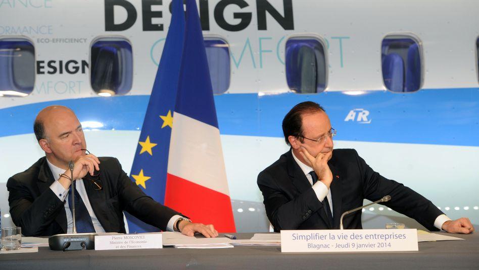 Frankreichs Finanzminister Moscovici (l.) und Präsident Hollande: Kampf gegen die Schulden