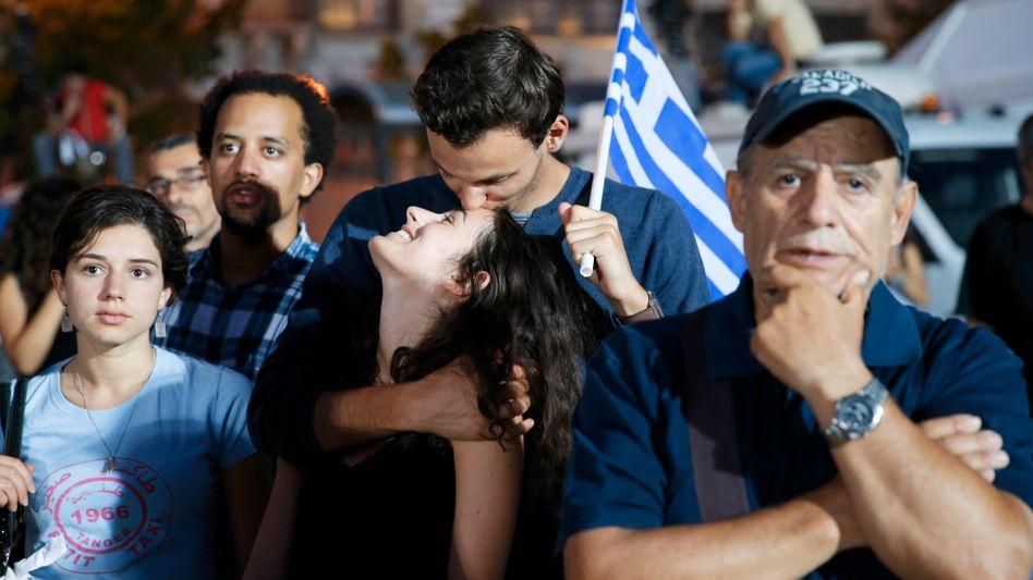 Blick in eine ungewisse Zukunft: Syriza-Anhänger vor dem Parlament