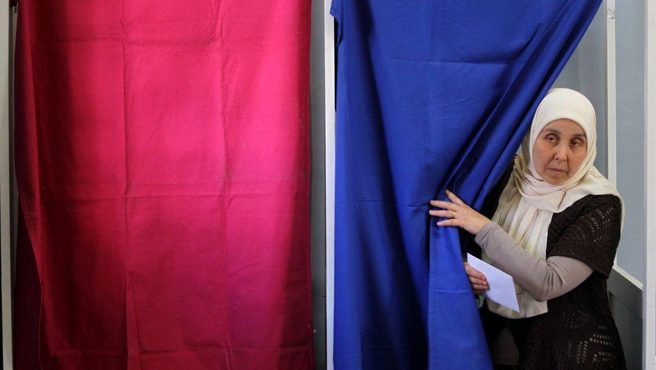 Wahlkabine in Algier: Die Abstimmung brachte kaum Veränderung