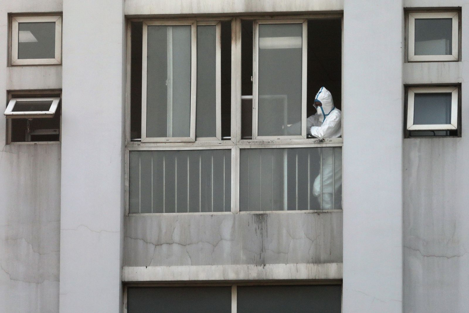 A medical staff is seen by a window at the Jinyintan hospital, where the patients with pneumonia caused by the new strain of coronavirus are being treated, in Wuhan
