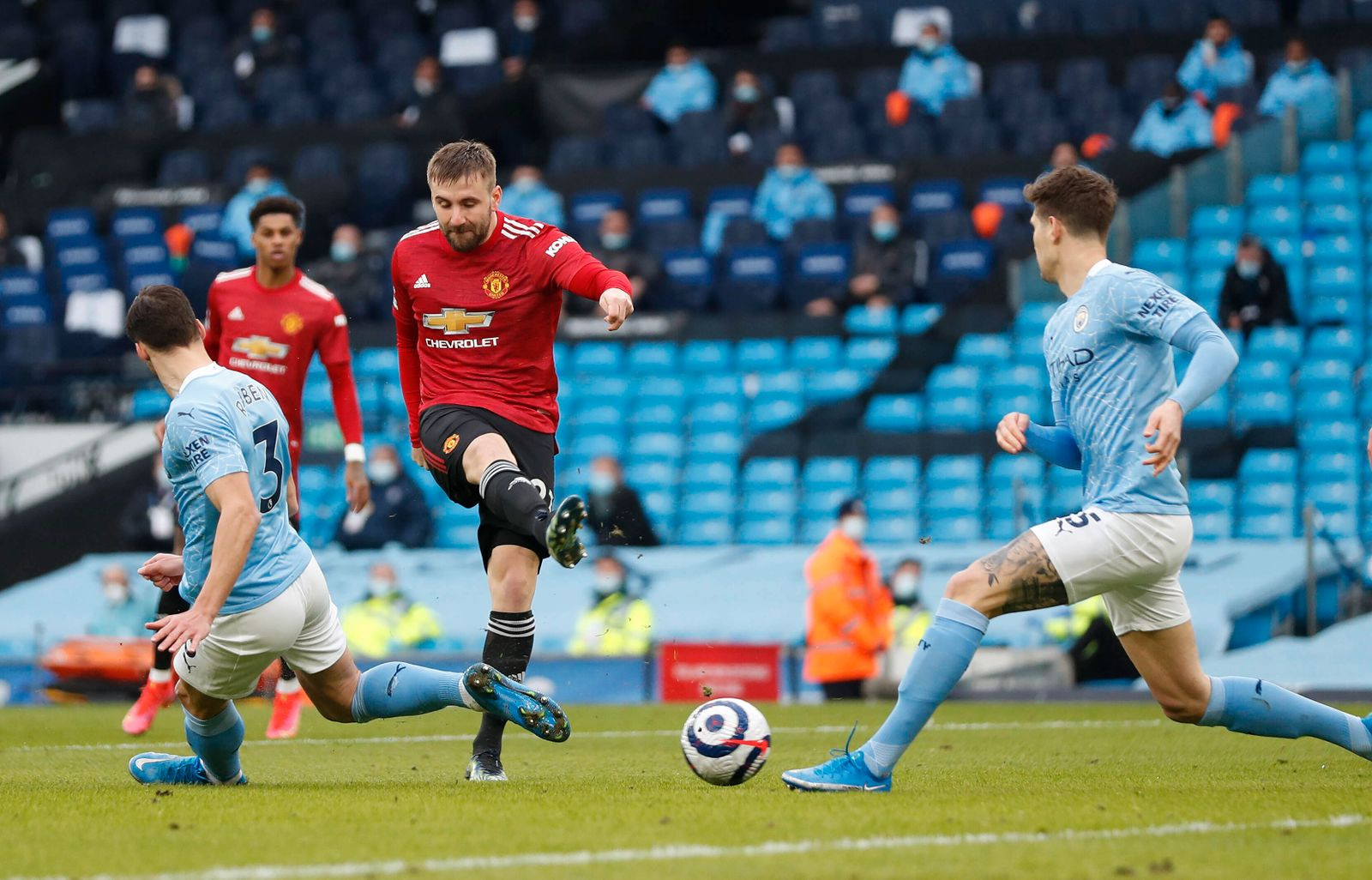 Luke Shaw of Manchester United, ManU takes a shot during the Premier League match at the Etihad Stadium, Manchester. Pi