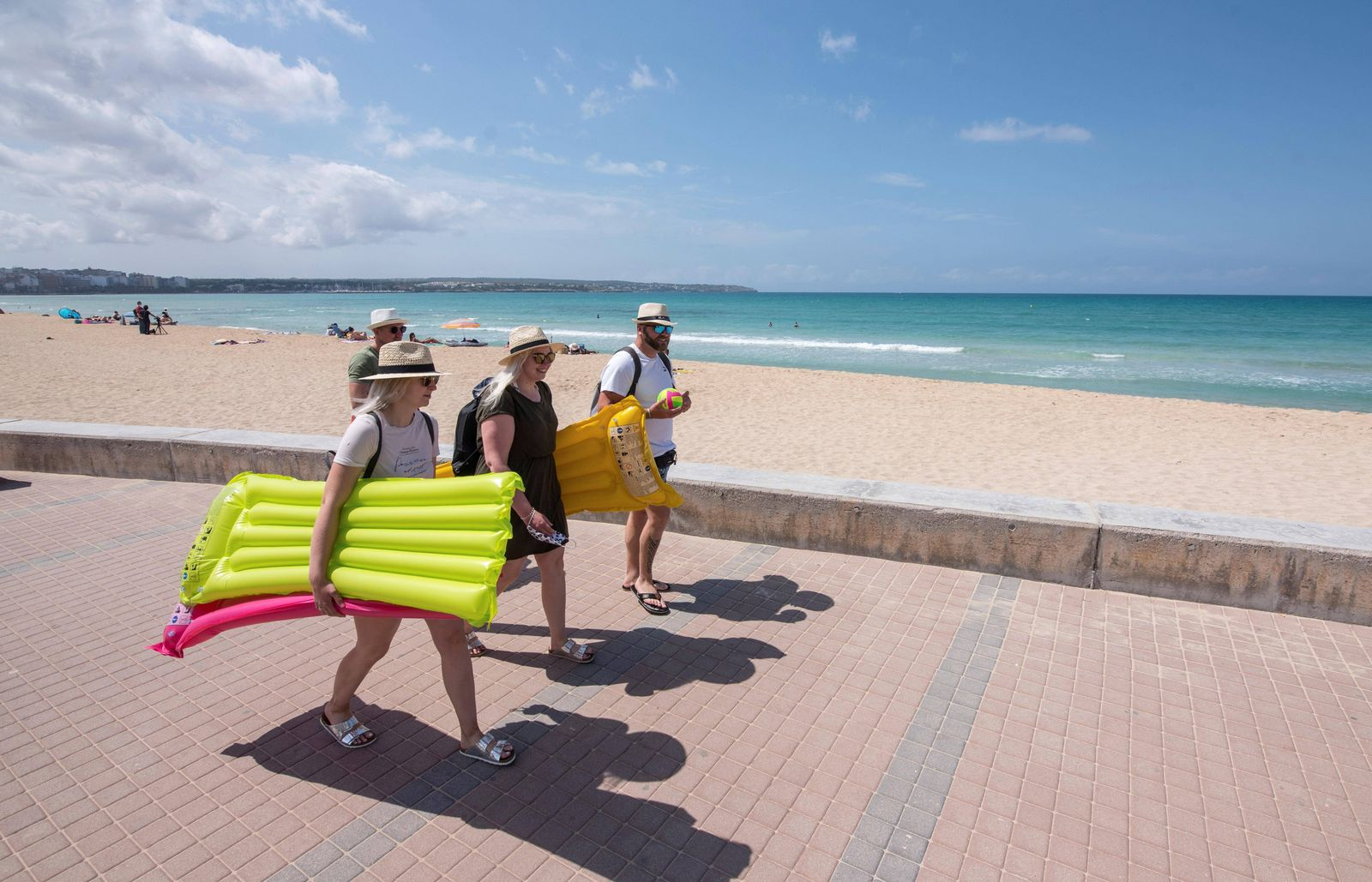 German tourists enjoy the sunny warm weather at a beach in Palma de Majorca, Spain, 16 June 2020. Up to 10,900 vacatione