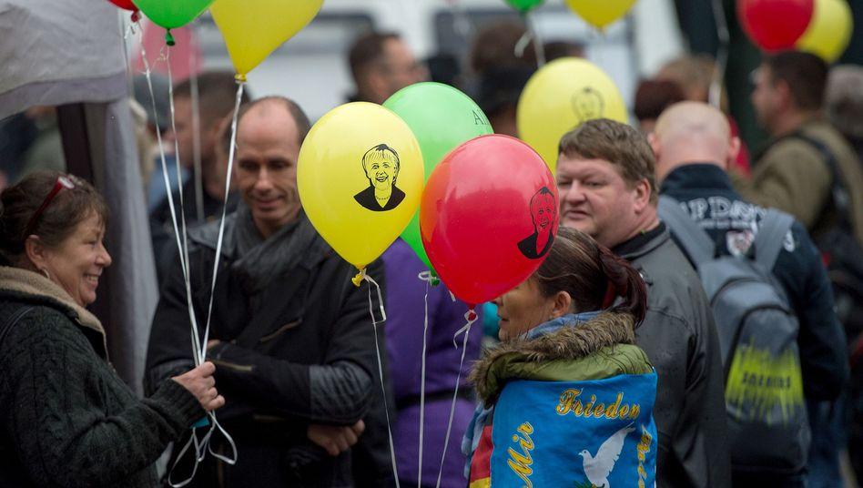 Kundgebung in Dresden am Tag der Deutschen Einheit, Merkel-Luftballons