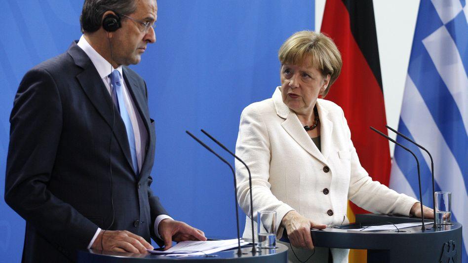 Athener Regierungschef Samaras, Kanzlerin Merkel: Sparkurs ist alternativlos